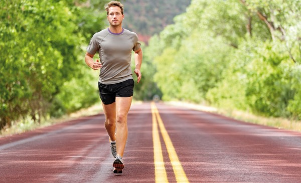Sport and fitness runner man running on road training for marath