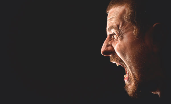 Portrait of angry man screaming in extreme rage